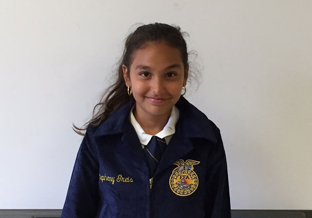 Stephany from the Horizon Academy at Marion Oaks FFA Chapter in Florida shows off her new jacket