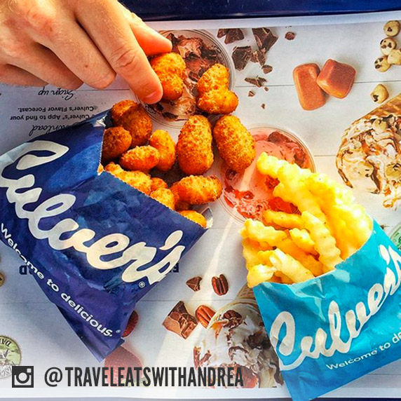 An order of Culver's cheese curds and an order of Culver's fries shown side-by-side on a restaurant tray.
