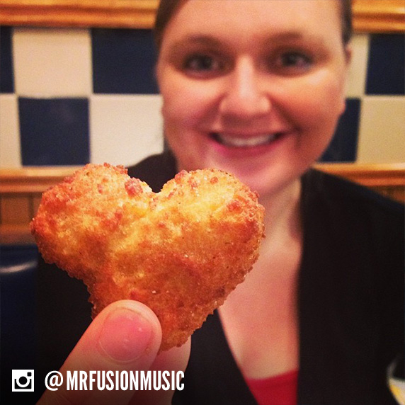 Culver's guest holding up a heart-shaped Cheese Curd.