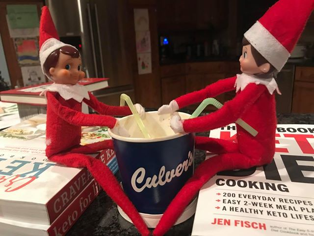 Guest image of two Elf on the Shelf dolls enjoying a pint of Fresh Frozen Custard together out of straws