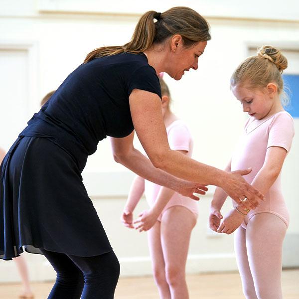 Ballet Hero - Photograph of ballet teacher teaching her students.