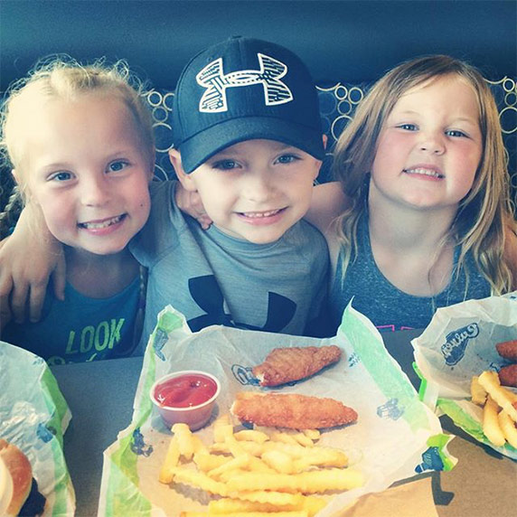 Kids enjoying Chicken Tenders.