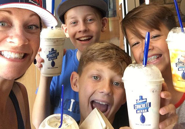 Link to story: Why You Should Stop at Culver's during the back to school season. A family in restaurant holding up Concrete Mixers.