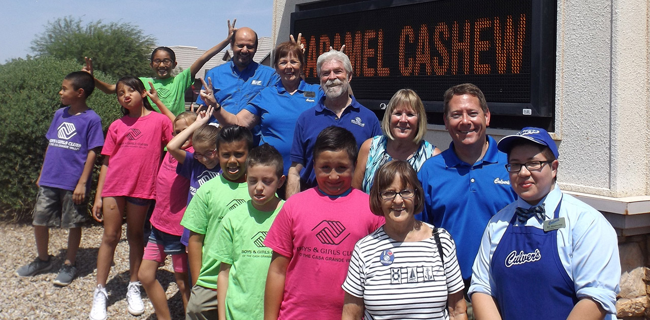 Culver's franchisee owners and Boys & Girls Club members outside of the restaurant.