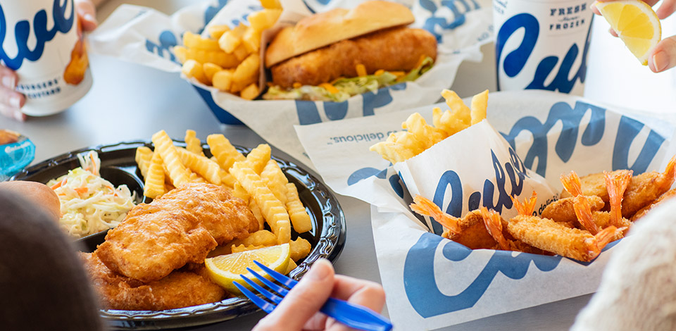 Shrimp basket, Cod dinner and Cod sandwich with crinkle cut fries as a side.
