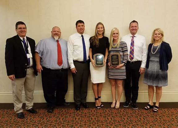 Photo of Franchisees of Portage, Wisconsin Culver's receive the Bert Grover Child Advocacy Award