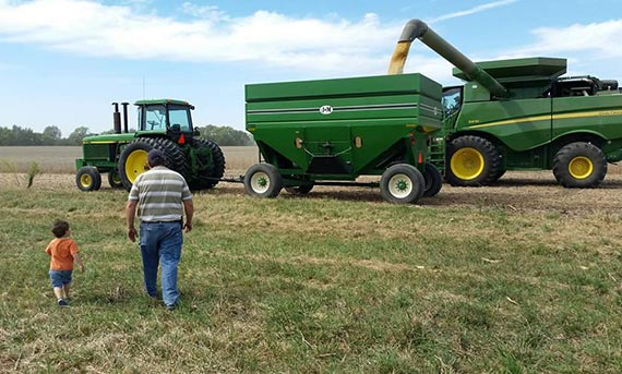 Chris Debolt and his son walking to the tractor.