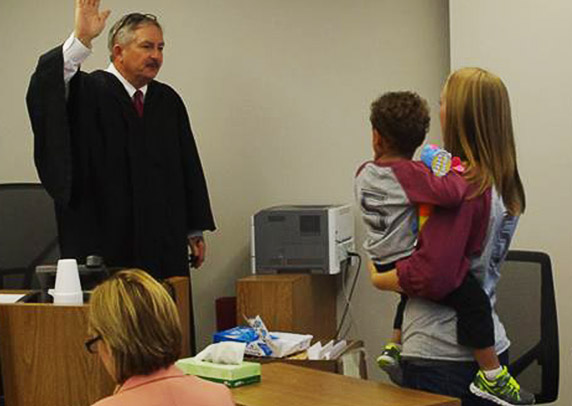 Black Hawk County Courthouse Chief Judge swears in a newly formed family