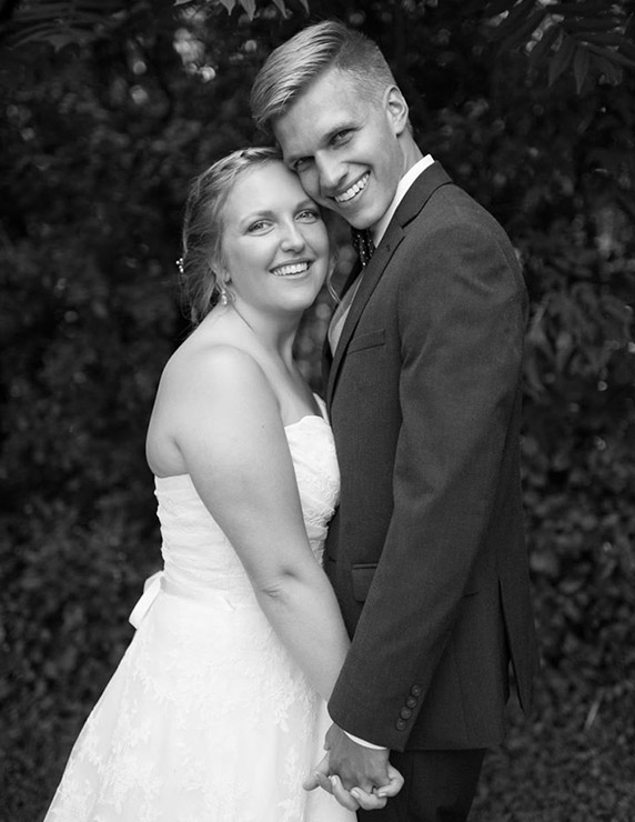 Hannah u. and her husband Eric on their wedding day