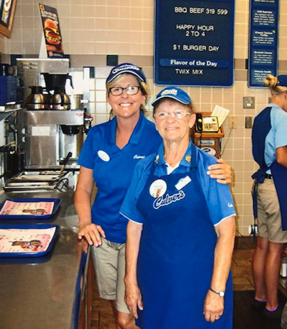 Sharon stands with a team member in the Culver's restaurant.