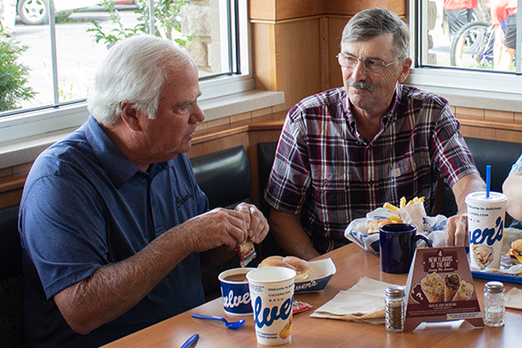 Craig Culver enjoys a meal in a corner booth with first guest Jim Olson.