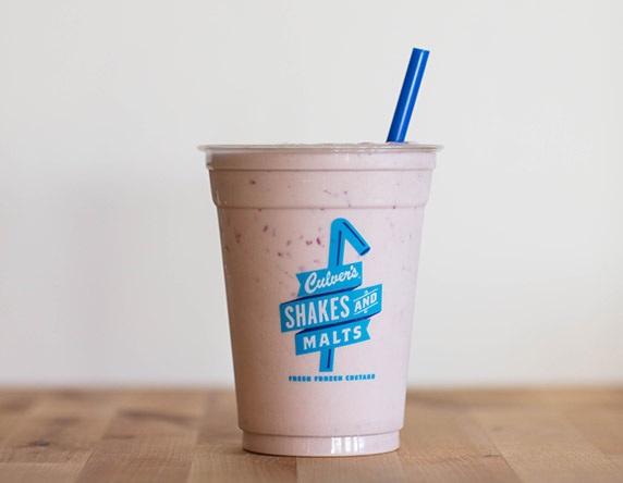 Culver's Raspberry Milkshake on a wooden table, waiting to be eaten.