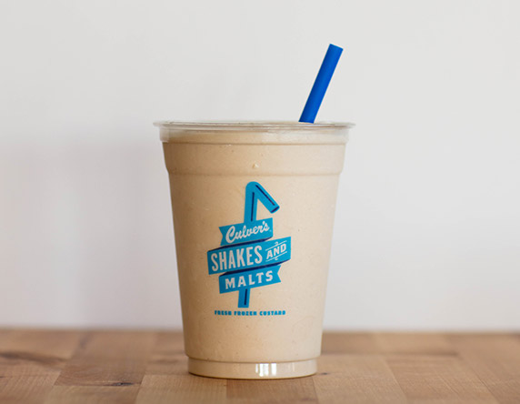 Culver's Peanut Butter Milkshake on a wooden table, waiting to be eaten.