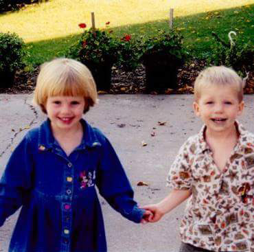 An old image of Kendal and Logan as little kids and holding hands.