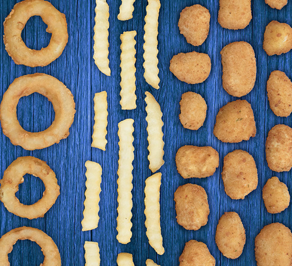 Onion Rings, Crinkle Cut Fries and Cheese Curds move in different directions in a GIF on top of a blue barn wood background.