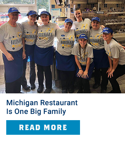 Team members pose for a photo in the restaurant