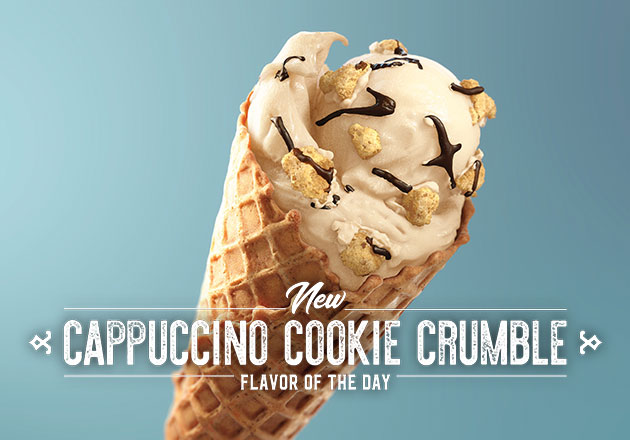 The New Cappuccino Cookie Crumble Flavor of the Day in a cone with a blue background