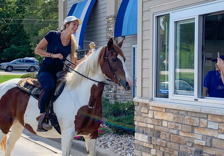 Link to story: Magical moments in the Culver's Drive-Thru. Pictured, a girl riding a horse through the Culver's Drive-Thru