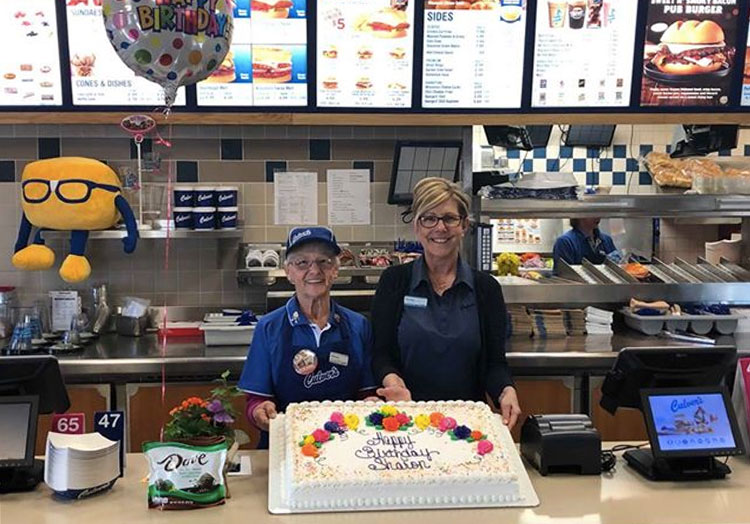 Sharon and the Culver's restaurant owner pose with a birthday cake.