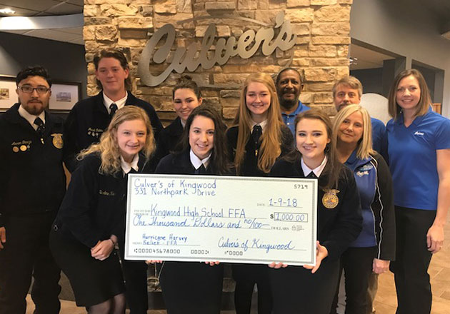 The KHS FFA receives a check at Culver's to rebuild their damaged barn.