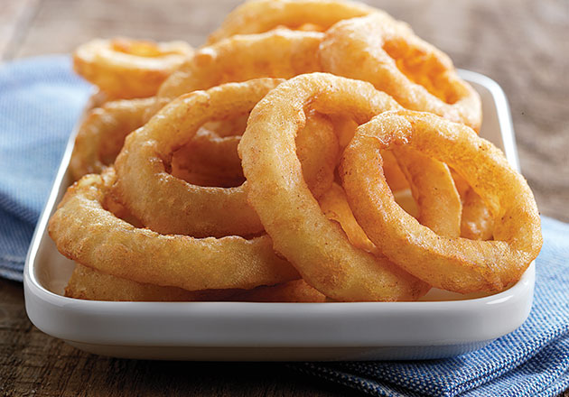Onion Rings sit in a dish