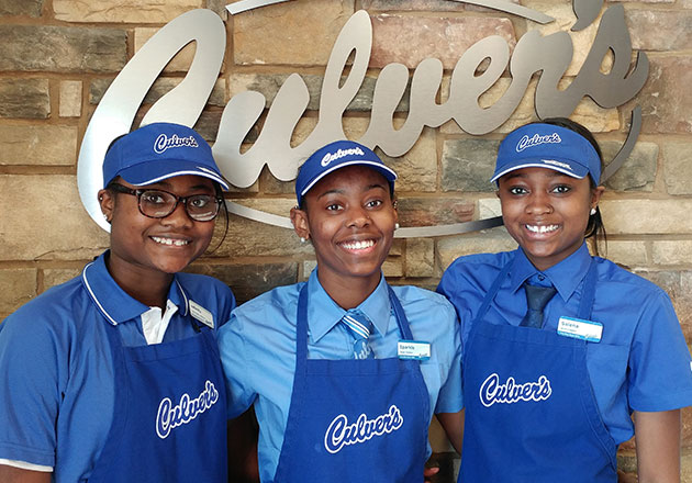 Left to right, sisters Infinity, Sparkle and Salena pose for a photo in their Culver's True Blue Crew uniforms in the Cedar Rapids, IA, restaurant.