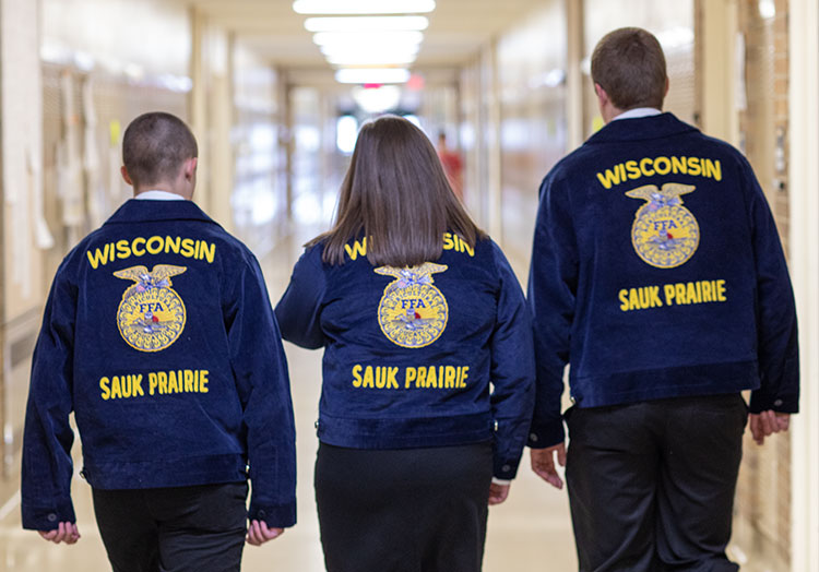 Group of FFA members walking through hall