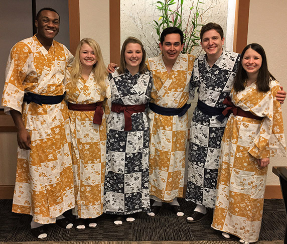National FFA members wearing kimonos in Japan.