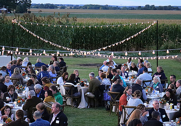 Illinois Harvest Dinner under a string of lights
