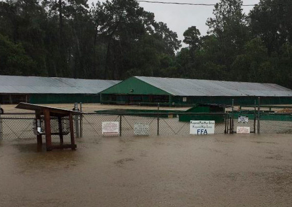The FFA barn took on 10 to 12 feet of water and was heavily damaged, in the image on the left.